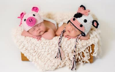 Twin-Baby-Girls-Wearing-Crocheted-Hats