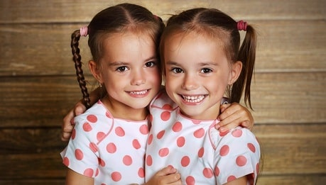 twin sisters happy together