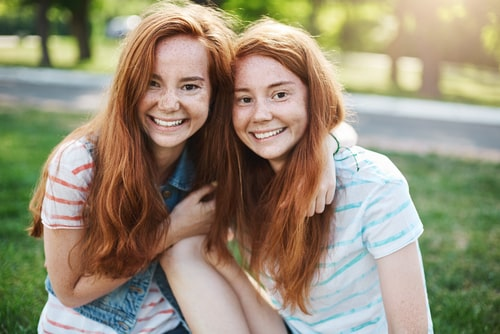 Teen twins hanging out with each other
