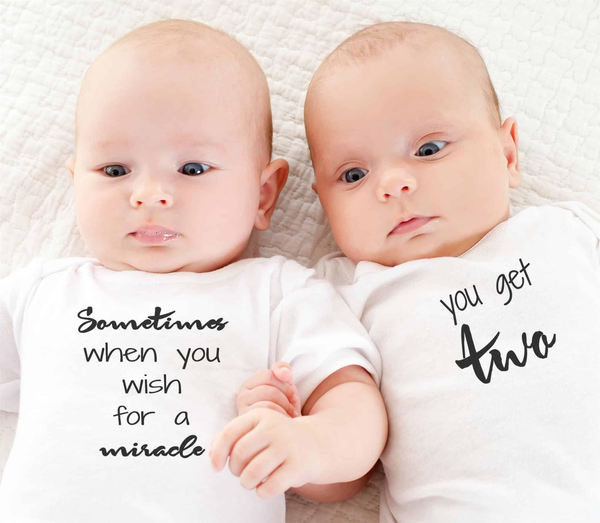 twins wearing twinstuff twin onesies