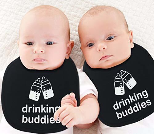 twins wearing matching bibs
