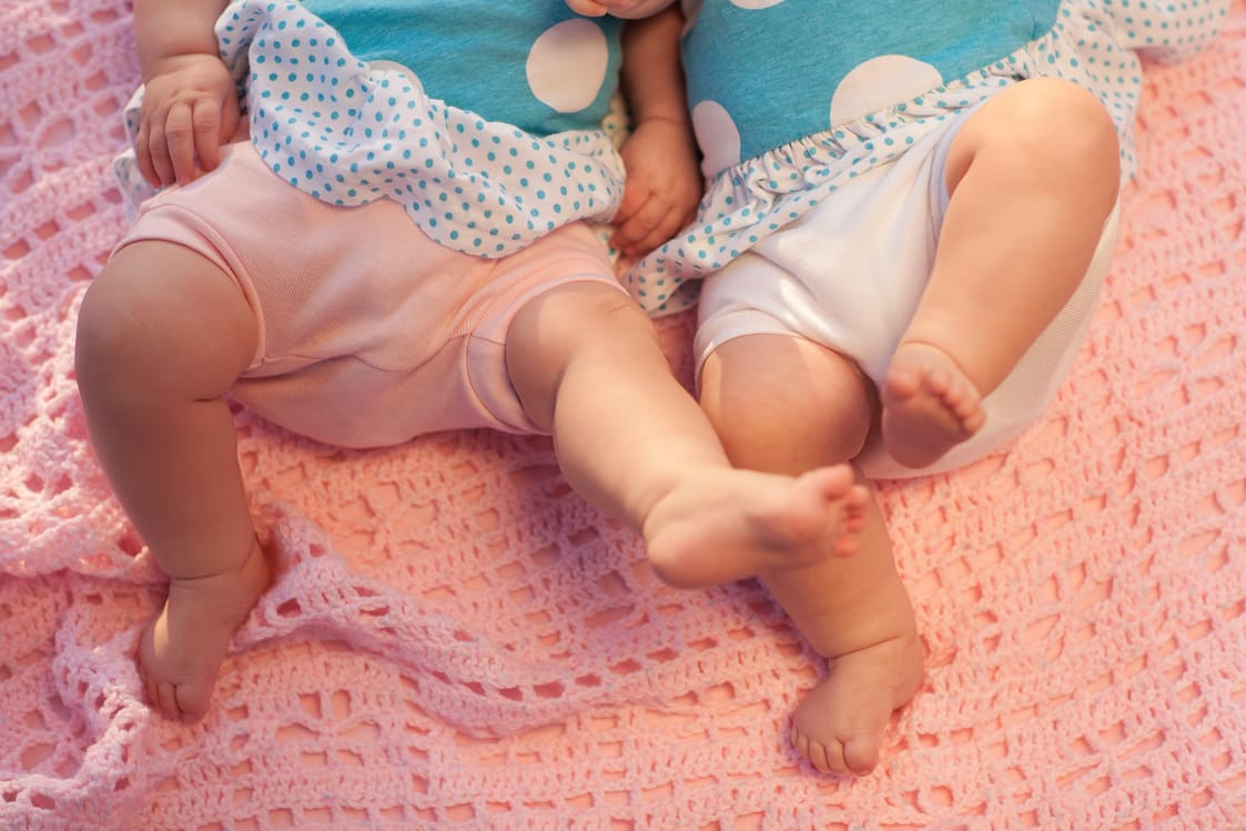 twins playing and kicking